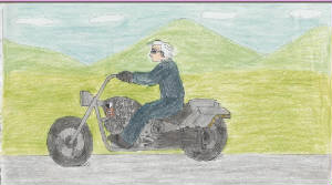 P.T. Boomer crusing along on his motorcycle